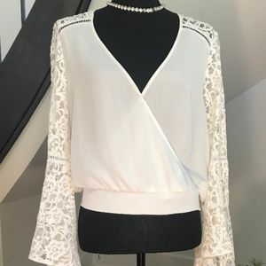 Stunning BeBe bell lace sleeved top